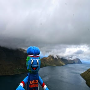 Globie catching a view of the serpentine island of Kalsoy from atop a mountain in the Faroes.